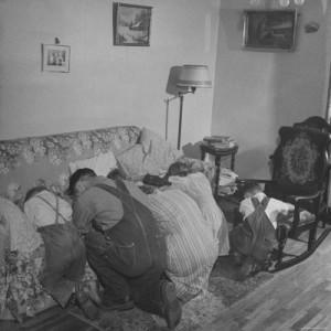 family praying in the morning